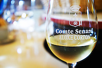glass of corton domaine comte senard aloxe-corton cote de beaune burgundy france
