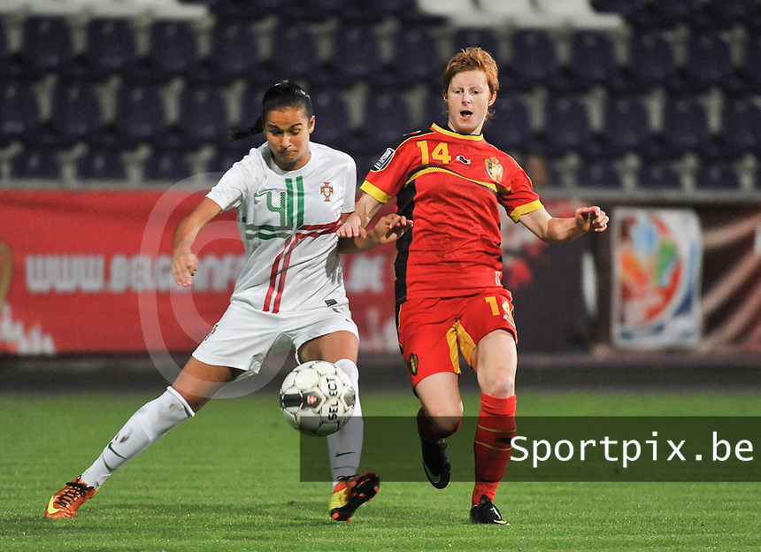 20131031 - ANTWERPEN , BELGIUM : Belgian Lien Mermans (14) pictured in a duel with Portugese Melissa Gomes (4)  during the female soccer match between Belgium and Portugal , on the fourth matchday in group 5 of the UEFA qualifying round to the FIFA Women World Cup in Canada 2015 at Het Kiel stadium , Antwerp . Thursday 31st October 2013. PHOTO DAVID CATRY