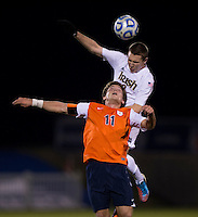 Connor Klekota (3) of Notre Dame goes up for a header with Eric Bird (11) of Virginia during the ACC tournament semifinals at the Maryland SoccerPlex in Boyds, MD.  Virginia advanced to the finals after tying Notre Dame, 3-3, in overtime and then defeating them on penalty kicks.