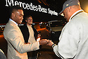 New Orleans Saints Wide Receiver Brandin Cooks hands the keys of a Mercedes-Benz Metris Passenger Van to local hero Pastor Fred Luter Jr., a reward for his contributions following Hurricane Katrina, on November 23, 2015.