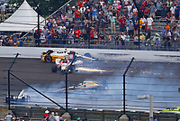 May 28, 2017; Indianapolis, IN, USA; IndyCar Series drivers James Davison (18), Oriol Servia (16), James Hinchcliffe (5) and Will Power (12) crash during the 101st Running of the Indianapolis 500 at Indianapolis Motor Speedway. Mandatory Credit: Mark J. Rebilas-USA TODAY Sports