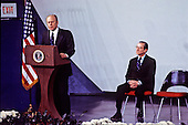 United States President Gerald R. Ford makes remarks at the swearing-in ceremony for George H.W. Bush as Director of the Central Intelligence Agency (CIA) at the agency's headquarters in Langley, Virginia on January 30, 1976.  Former CIA Director William Colby looks on from right.<br /> Credit: Barry Soorenko / CNP