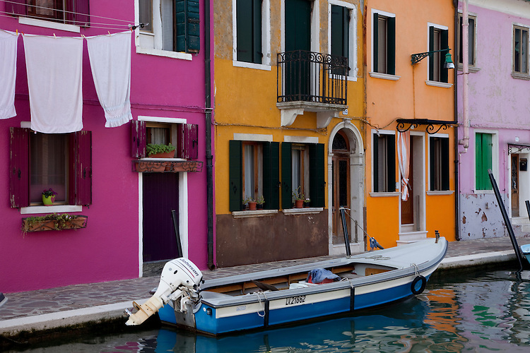 Burano is famous for picturesque pastel houses lining boat-filled canals