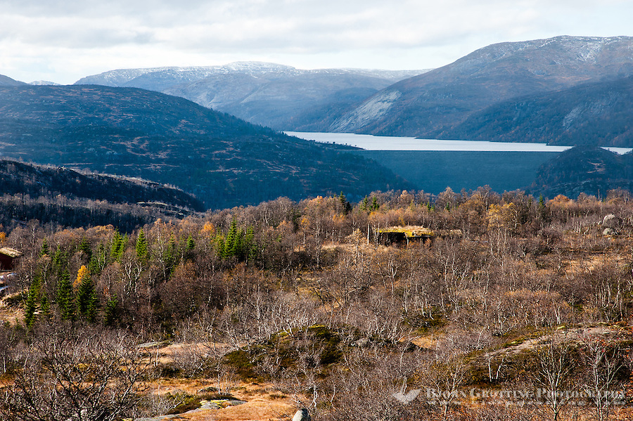 The first snowfall of the season in the mountains around Fidjeland, Sirdal, Norway. Valevatn water reservoir and dam in the background.
