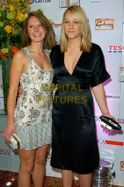 CHLOE MADELEY & GUEST.The Galaxy British Book Awards, Grosvenor House Hotel, London, England..March 28th, 2007.half length black dress white pattern clutch purse.CAP/CAN.©Can Nguyen/Capital Pictures