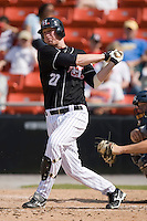 Erik Huber (27) of the Hickory Crawdads follows through on his swing versus the Charleston RiverDogs at L.P. Frans Stadium in Hickory, NC, Sunday, May 4, 2008.