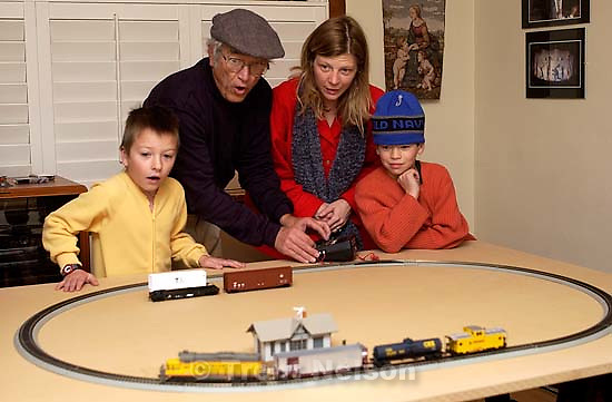 Salt Lake City - Noah Nelson, Ed Quayle, Laura Nelson, Ed Zambrano with electric train set Ed gave the kids. Christmas. 12.25.2002, 6:31:57 AM<br />