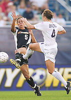 Shannon Boxx of the Power and Kylie Bivens of the Beat both go for the ball. The Atlanta Beat and the NY Power played to a 1-1 tie on 7/26/03 at Mitchel Athletic Complex, Uniondale, NY. Boxx scored the Power's lone goal in the 61 minute.