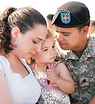 Specialist Jose Aparicio  spends some final moments with his family, wife Jenifer Faria and daughter Avyana Aparicio, 2, all of Hyattsville before his unit, Company B, 1st Battalion, 175th Infantry Regiment of the Maryland National Guard deploys for Fort Dix in New Jersey and then to Iraq from the White Oak Armory in Silver Spring on Friday morning.