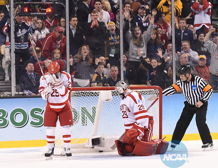 11 APR 2015:   Brandon Fortunato (25) and Matt O'Connor (29) of the Boston University Terriers gives up a goal against Providence College Friars during the Division I Men's Ice Hockey Championship held at the TD Garden in Boston, MA.  Providence defeated Boston 4-3 for the national title.  Steve Babineau/NCAA Photos
