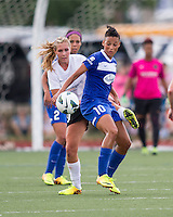 In a National Women's Soccer League Elite (NWSL) match, Portland Thorns FC defeated the Boston Breakers, 2-1, at Dilboy Stadium on July 21, 2013.  Portland Thorns FC midfielder Allie Long (10) and Boston Breakers forward Lianne Sanderson (10) battle for a high ball.
