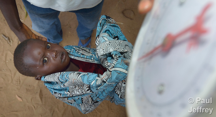 A baby gets weighed in Kalikumbi, Malawi, where the Maternal, Newborn and Child Health program of the Livingstonia Synod of the Church of Central Africa Presbyterian has helped families stay healthy.