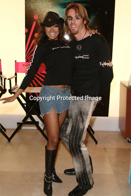 Traci Bingham &amp; Adam Darais<br />MAC AIDS Fund and Viva Glam on World Aids Day<br />MAC Store<br />Hollywood, CA, USA<br />December 1, 2003 <br />Photo By Celebrityvibe.com /Photovibe.com