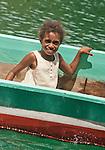 Girl in longboat, Kaimana area Papua.