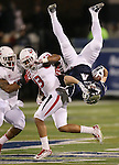 Nevada's Kendall Brock (4) flips through the air after making a reception against Fresno State's Derron Smith (13) and Karl Mickelsen (43) during the first half of an NCAA college football game in Reno, Nev., on Saturday, Nov. 22, 2014. (AP Photo/Cathleen Allison)