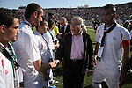 Palestinian prime minister Salam Fayyad shakes hand with Palestinian players during a friendly football match between the Palestinian and Italian Olympic teams to mark the inauguration of the Dura Stadium near the West Bank city of Hebron on June 12, 2011. Photo by Najeh Hashlamoun ..