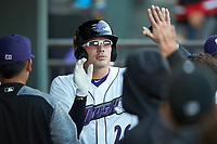 Craig Dedelow (26) of the Winston-Salem Dash high fives teammates after hitting a home run against the \ at BB&T Ballpark on April 15, 2019 in Winston-Salem, North Carolina. The Dash defeated the Blue Rocks 9-8. (Brian Westerholt/Four Seam Images)