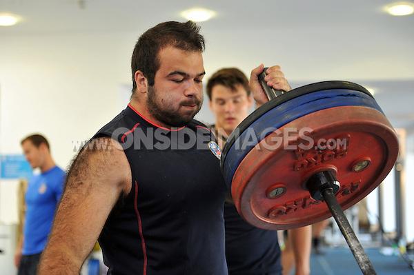 Kane Palma-Newport in the gym. Bath Rugby pre-season training on July 16, 2013 at Farleigh House in Bath, England. Photo by: Patrick Khachfe/Onside Images