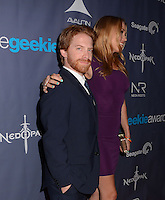 Seth Green, Clare Grant<br /> The first annual Geekie Awards at The Avalon Hollywood in Hollywood, CA., USA.  <br /> August 18th, 2013<br /> half length beard facial hair black suit side profile purple dress tall short married husband wife <br /> CAP/ADM/BT<br /> &copy;Birdie Thompson/AdMedia/Capital Pictures