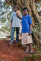 Ivan Matovu, 13, and his grandmother Deziranta Namigadde, around 50, in the yard by their home at Kyambogo University sports ground, Uganda on July 28 2011. Ivan is the starting pitcher for Rev. John Foundation Little League baseball team.
