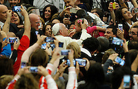 Pope Francis caresses a child as he arrives to lead an audience with young volunteers from Italy's National Civil Service in Paul the VI hall at the Vatican, on November 26, 2016.<br /> UPDATE IMAGES PRESS/Isabella Bonotto<br /> <br /> STRICTLY ONLY FOR EDITORIAL USE