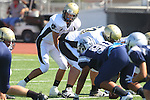 Torrance, CA 09/08/11 - Luca Sartini (Peninsula #73) and Ian Escutia (Peninsula #2) in action during the North-Peninsula Junior Varsity Football game at North High School in Torrance.