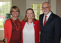 NWA Democrat-Gazette/CARIN SCHOPPMEYER Melissa Hawkins (from left), and Sandy Steinmetz and UA Chancelor Joseph Steinmetz gather at the Women's Giving Circle voting event at University House on the UA campus in Fayetteville