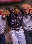 28 April 2017: Washington Nationals outfielder Adam Eaton is helped off the field after injuring his ankle crossing first base in the 9th inning against the New York Mets at Nationals Park in Washington, DC. The Mets defeated the Nationals 7-5 to take the first game of their 3-game weekend series. Mandatory Credit: Ed Wolfstein Photo *** RAW (NEF) Image File Available ***