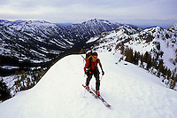 Rob Hahn reaching the top of Carne Mountain, Glacier Peak Wilderness, Washington, USA