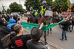 © Joel Goodman - 07973 332324 - all rights reserved . 14/07/2012 . Bristol , UK . Mounted police clash with anti fascists . Demonstrations by the EDL and a counter demonstration by antifascists in Bristol . Photo credit : Joel Goodman