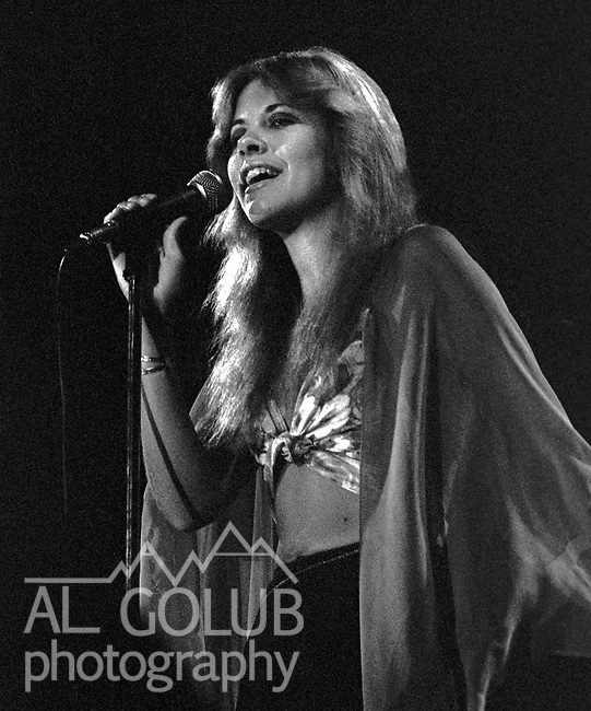 Stevie Nicks<br /> Modesto, California&mdash;Some time in early 1976, Fleetwood Mac Kingfish and an unknown at this time other groups played For Jerry Schweitzer at the Olympic Gold Ice Arena. Fleetwood Mac performers were Mick Fleetwood (drums) Stevie Nicks (vocals), John McVie (bass)  Christine McVie (keyboard) and Lindsey Buckingham (lead Guitar)Photo by Al Golub/Golub Photography