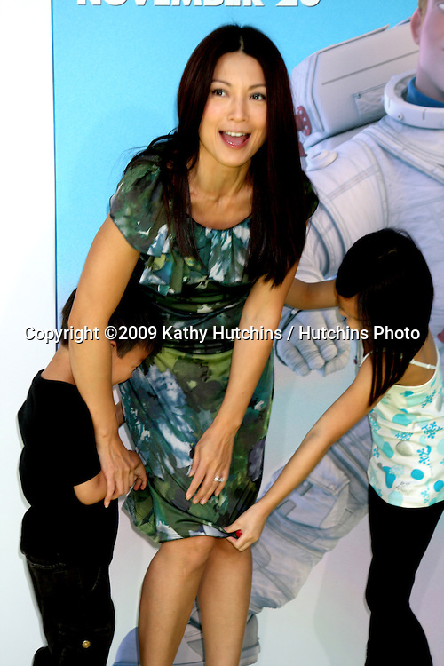 Ming-Na & children.arriving at the Planet 41 Movie Premiere.Mann's Village Theater - Westwood.Los Angeles,  CA.November 14, 2009.©2009 Kathy Hutchins / Hutchins Photo.