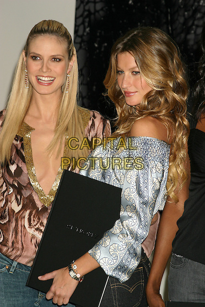 "HEIDI KLUM & GISELE BUNDCHEN.Victoria's Secret ""Sexy Volume 3: A Tribute to a Decade of Sexy Swimwear"" Launch Party,  Milk Studios, New York City, USA, April 5th 2005.half length.Ref: IW.www.capitalpictures.com.sales@capitalpictures.com.©Ian Wilson/Capital Pictures."