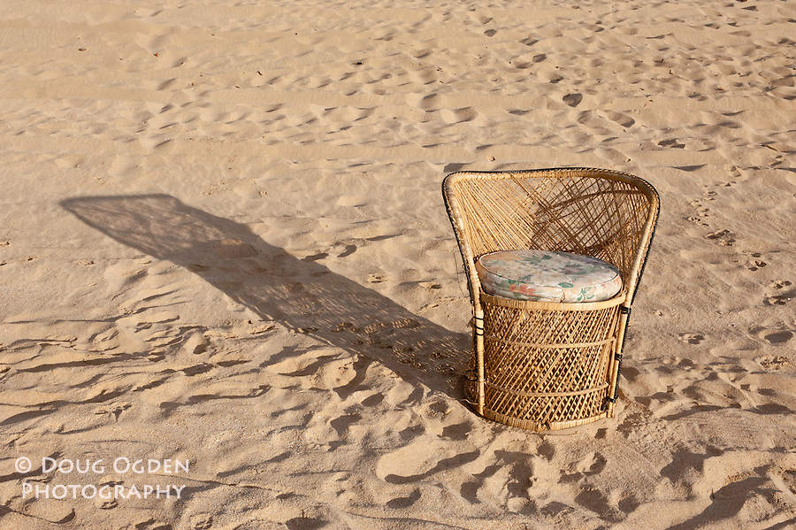 Wicker with shadow on sand, Kauai, Hawaii