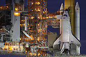 At the National Aeronautics and Space Administration's (NASA) Kennedy Space Center in Florida, the STS-133 payload canister is lifted into the rotating service structure on Launch Pad 39A on October 7, 2010. After the structure is closed around space shuttle Discovery, the canister's contents will be transferred into the shuttle's payload bay. Discovery and its STS-133 crew will deliver the Permanent Multipurpose Module, packed with supplies and critical spare parts, as well as Robonaut 2, the dexterous humanoid astronaut helper, to the International Space Station.  STS-133, aboard the Space Shuttle Discovery, is scheduled for launch Monday, November 1, 2010 at 4:40 p.m. EDT..Mandatory Credit: Troy Cryder / NASA via CNP