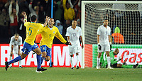 Luis Fabiano of Brazil celebrates scoring his side's second goal as USA players look dejected. Brazil defeated USA 3-2 in the FIFA Confederations Cup Final at Ellis Park Stadium in Johannesburg, South Africa on June 28, 2009.