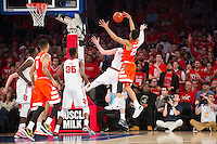 NEW YORK, NY - Sunday December 13, 2015: Amar Alibegovic (#1) of St. John's, left, and Malachi Richardson (#23) of Syracuse fight for a rebound.  St. John's defeats Syracuse 84-72 during the NCAA men's basketball regular season at Madison Square Garden in New York City.