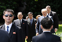US President Donald Trump (2-R)  walks  with Kim Yong Chol (2-L), former North Korean military intelligence chief and one of leader Kim Jong Un's closest aides, as Secretary of State Mike Pompeo (R) looks on  outside the  Oval Office of the White House in Washington on Friday, June 1, 2018. <br /> CAP/MPI/RS<br /> &copy;RS/MPI/Capital Pictures