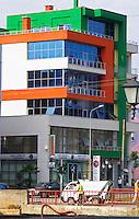 Street scene with typical colourful houses along the boulevard Bulevardi Bajram Curri. Tirana capital. Albania, Balkan, Europe.