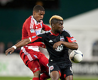 Brandon McDonald (4) of D.C. United fights for the ball with Luis Perea (15) of FC Dallas at RFK Stadium in Washington DC.   Dallas FC fell to D.C. United, 4-1.