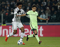 Calcio, Champions League: Gruppo D - Juventus vs Manchester City. Torino, Juventus Stadium, 25 novembre 2015. <br /> Juventus&rsquo; Juan Cuadrado, left, is challenged by Manchester City's Jesus Navas during the Group D Champions League football match between Juventus and Manchester City at Turin's Juventus Stadium, 25 November 2015. <br /> UPDATE IMAGES PRESS/Isabella Bonotto