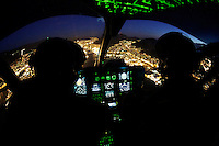 Norwegian Air Ambulance helicopter fly over Bergen by night, during a training session.