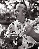 USA, Hawaii, The Big Island, a man plays the Ukulele at the Four Seasons Resort on The Big Island (B&W)
