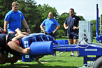 Head of Sports Medicine Richard Mack and Charlie Beech look on as the Bath forwards practise their scrummaging. Bath Rugby training session on August 27, 2013 at Farleigh House in Bath, England. Photo by: Patrick Khachfe/Onside Images