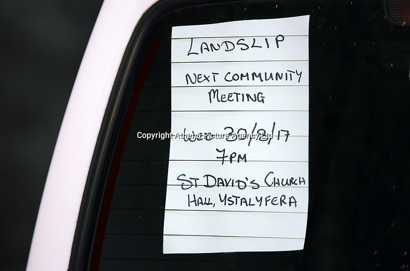 A post informing local residents about the next community meeting on a car about terraced houses in Cyfyng Road, which have been either abandoned or evacuated over fears of a landslide in the area in Ystalyfera, Wales, UK. Wednesday 30 August 2017