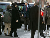 "United States President George W. Bush waits for First Lady Laura Bush to get out of the limousine before attend church at St. John's Church December 11, 2005 in Washington, DC. St. John's is also known as ""The President's Church"" because it is directly across Lafayette Park from the White House. <br /> Credit: Chip Somodevilla / Pool via CNP <br /> <br /> Pool Report #1 - 12/11/05 -- Your poolers arose with the songbirds and barely had time to hit Starbucks before the motorcade was rolling. By 7:40 am, Potus and Mrs. Bush were in their car, on the way to St. John's Church, where they sat on the left side of the center aisle, about three rows back. Robert Mueller was across the aisle.  Rev. Luis Leon gave the sermon, talking about the important of not compartmentalizing faith by simply attending church and following ritual.  ""We have to experience God, we don't want to create a box around'' religion he said. He veered into the political by discussing the ""checklists'' some apply to faith, with questions such as ""Are you for same-sex marriage or not.'' That drew laughter; from where we were sitting in the back we could not see if either the President or Mrs. Bush joined in the laughter. He discussed emails he received, including one from someone who asked ""How dare you preach in front of the President,'' and apparently assuming that because Rev. Leon was born in Guantanamo he was a follower of ideologies the president should not be hearing about.   ""Well, hello, I'm rector of the church,'' he said with a laugh.  He concluded with: ""Expect the unexpected. God offers maximum support but minimum protection.''  The pool got a brief wave from POTUS as he exited the church, then we did the world's shortest motorcade in reverse. Within 10 minutes we were rolling again, to Quantico. We stopped at traffic signals on 15th street, as inconspicuous as you can be in a 14 or 15-car motorcade can be with black-suited agents sitting in traffic with their automatic weapons. Once on the highway, other"