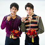 TAIPEI, TAIWAN - JANUARY 24:  Takahito Mura (R) and Takahiko Kozura of Japan pose with their medals after the Men Free Skating event during the Four Continents Figure Skating Championships on January 24, 2014 in Taipei, Taiwan.  Photo by Victor Fraile / Power Sport Images *** Local Caption *** Takahito Mura; Takahiko Kozura