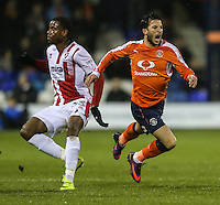 Luke Gambin of Luton Town (right) is fouled by Liam David of Cheltenham Town ((left) during the Sky Bet League 2 match between Luton Town and Cheltenham Town at Kenilworth Road, Luton, England on 31 January 2017. Photo by David Horn / PRiME Media Images