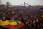 VAN, TURKEY: Turkish Kurds celebrate Newroz in Van, Turkey...Every year on March 21st, Kurds celebrate Newroz, the Kurdish new year. On March 21, 2013, Abudullah Ocalan, the imprisoned leader of the Kurdish separatist group, the PKK, called for his fighters to lay down their arms and retreat to northern Iraq...Photo by Refik Tekin/Metrography