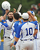 Division Avenue pitcher No. 22 Anthony Papa, left, gets congratulated by teammates after crossing home plate in the bottom of the first inning of the Class A varsity baseball Long Island Championship against Bayport-Blue Point at New York Institute of Technology on Saturday, June 6, 2015. He threw a shutout to lead Division to a 4-0 win.<br /> <br /> James Escher